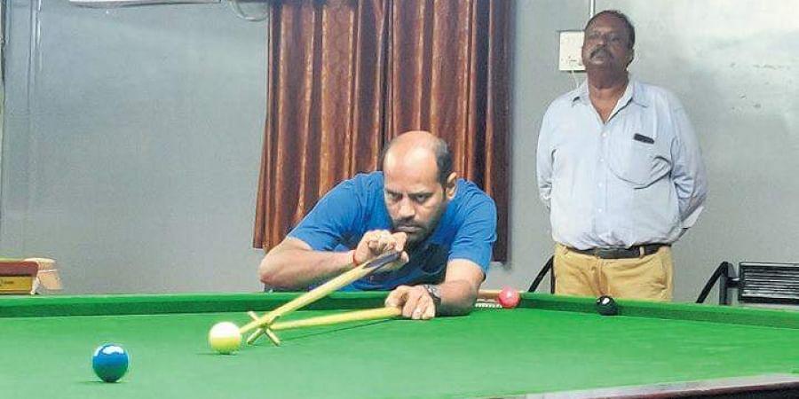 TNBSA's Hari Rajamani in action during the all India open snooker meet.