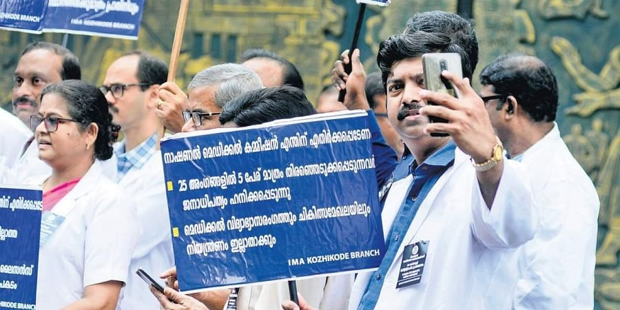 Members of IMA Kozhikode branch on Wednesday protesting against the National Medical Commission Bill passed by Lok Sabha.