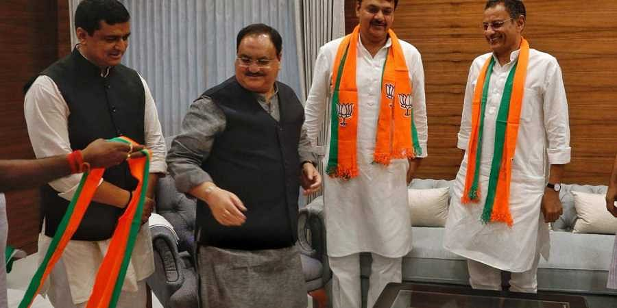 Samajwadi Party MPs Surender Sing  Nagar and Sanjay Seth join BJP in the presence of BJP working President JP Nadda at BJP HQ in New Delhi on saturday.