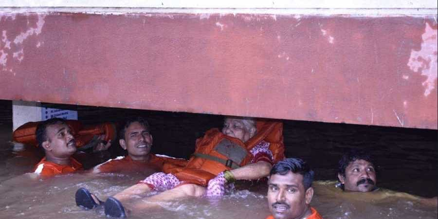 A NDRF team rescues an old woman in Pune