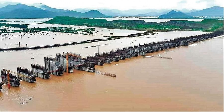 Godavari floodwater flowing over the spillway of Polavaram project in West Godavari district on Friday