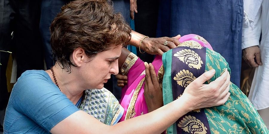 Congress General Secretary Priyanka Gandhi Vadra consoles a family member of a Sonbhadra massacre victim who had travelled to Chunar Fort to meet her after the former was stopped from proceeding to Sonbhadra in Mirzapur on 20 July 2019. (Photo | PTI)