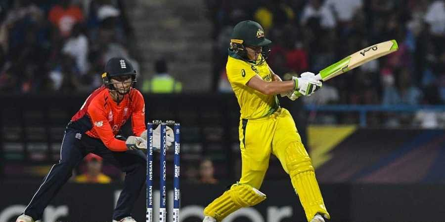 Alyssa Healy (R) of Australia hits 4 as Amy Jones of England looks on during the ICC Women's World T20 final cricket match between Australia and England. (File | AFP)