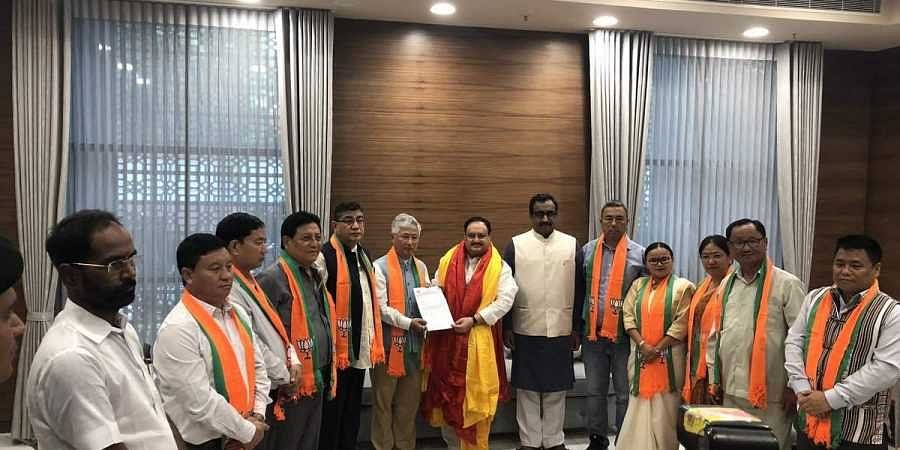 Sikkim Democratic Front MLAs join BJP in the presence of working president JP Nadda and general secretary Ram Madhav