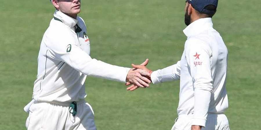 Steve Smith (L) and India's captain Virat Kohli. (Photo | AFP)