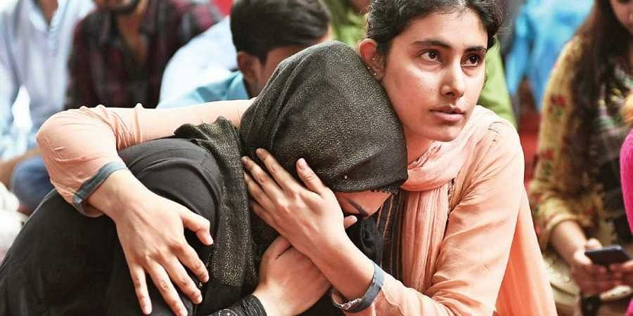A Kashmiri woman breaks down after listening to a fellow Kashmiri narrating memories of past Eid in the Valley. Kashmiris living in Delhi gathered at Jantar Mantar on Monday to observe Eid al-Adha.