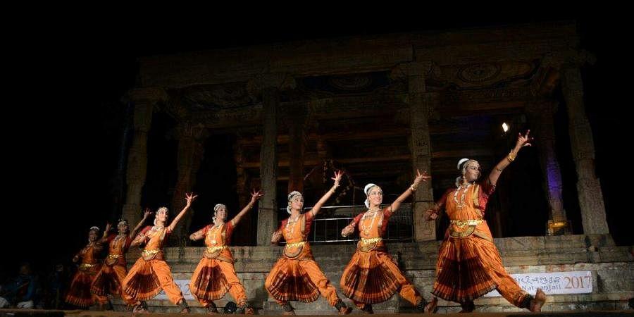 Lord Shiva's Lasya and Thandava sought to be captured by young artistes performing the classical Bharatanatyam dance as part of Maha Shivaratri celebrations at the renowned Brihadeeswarar temple (Big Temple) In Thanjavur. (M K Ashok Kumar | EPS)