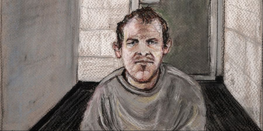 In this courtroom drawing, Brenton Tarrant, the man accused of killing 51 people at two Christchurch mosques on March 15, 2019 appears via video link at the Christchurch District Court, from the maximum security prison in Auckland where he's being held