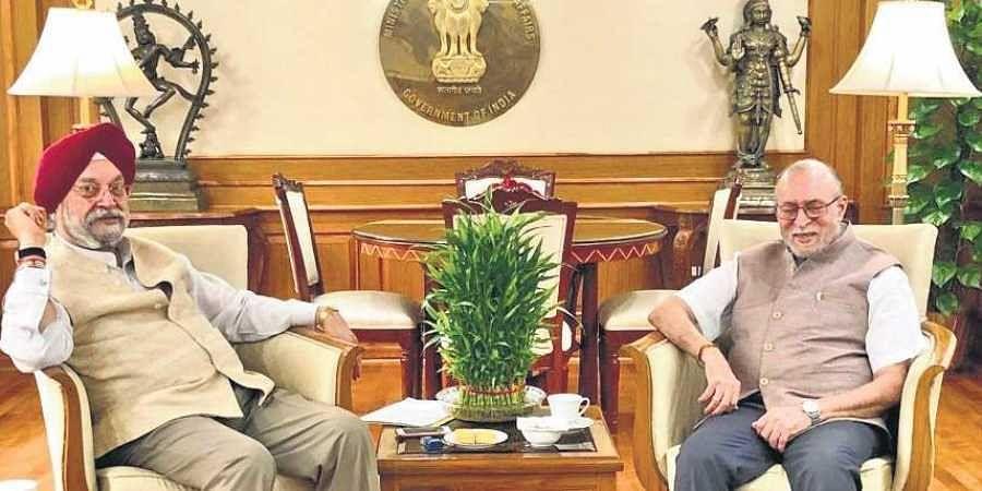 Union minister Hardeep Singh Puri with Delhi Lieutenant Governor Anil Baijal on Tuesday