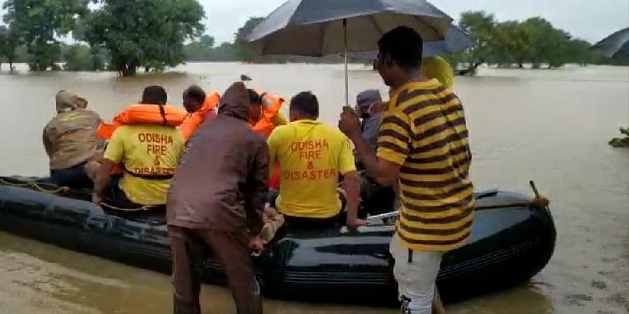 Odisha fire services personnel deployed in rescue operation in Kalahandi district.