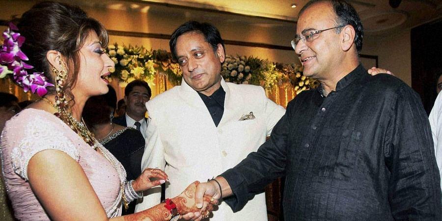 Arun Jaitley greets Sunanda Pushkar and Shashi Tharoor