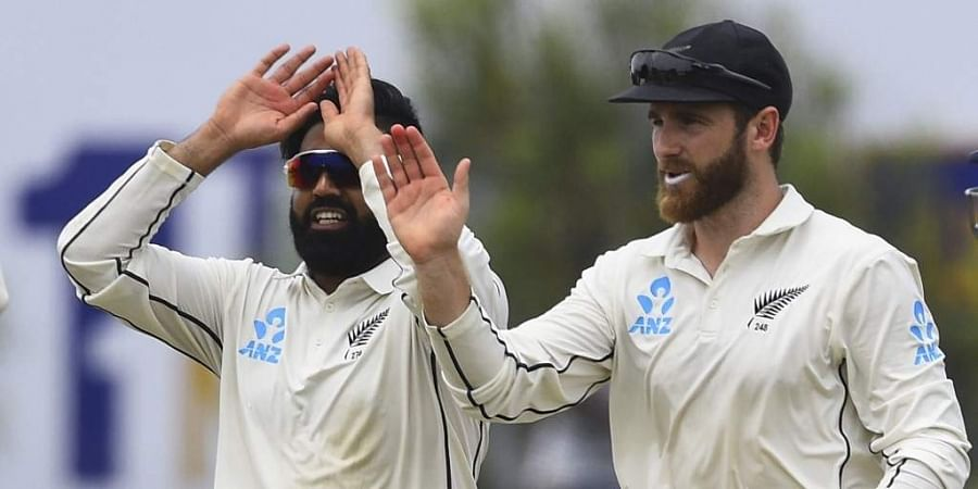 New Zealand's Ajaz Patel (L) celebrates with teammate team captain Kane Williamson. (Photo | AFP)