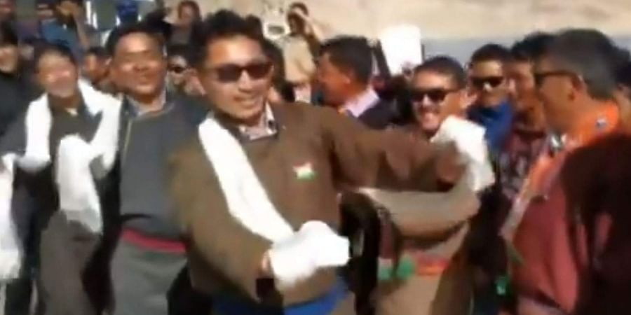 BJP MP from Ladakh, Jamyang Tsering Namgyal (in front) dances while celebrating Independence Day in Leh