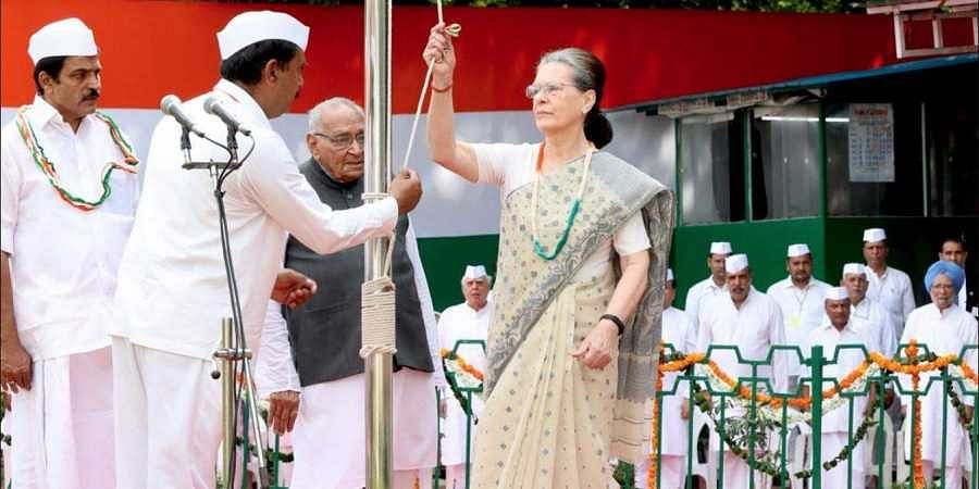 Congress interim President Sonia Gandhi hoists the national flag at AICC HQ in Delhi