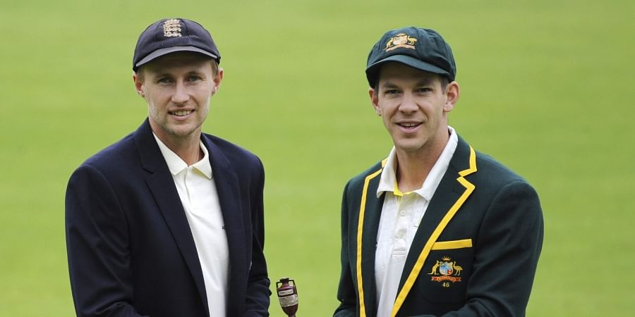 England captain Joe Root, left, and Australia's captain Tim Paine pose with the Ashes urn.