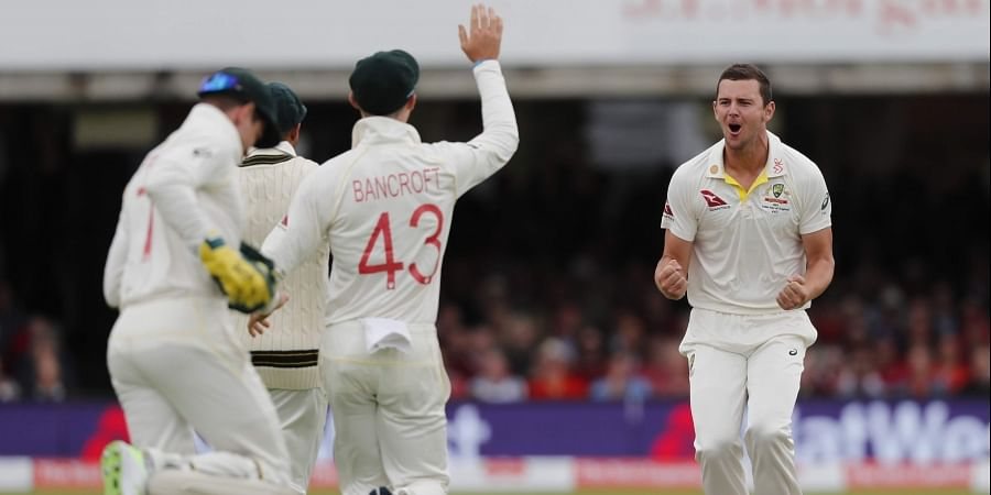 Australia's Josh Hazlewood celebrates taking the wicket of England's Jason Roy during the second day of the second Ashes test match between England and Australia.