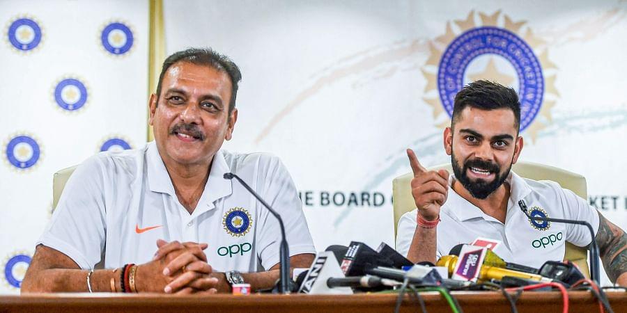 Indian head coach Ravi Shastri and cricket team captain Virat Kohli. (Photo   PTI)