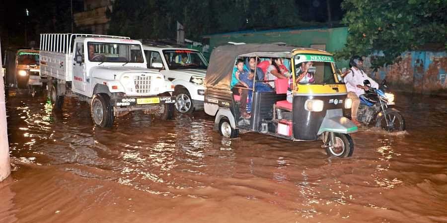 Vehicle wading through water logged oat Bomikhal road in Bhubaneswar on Friday