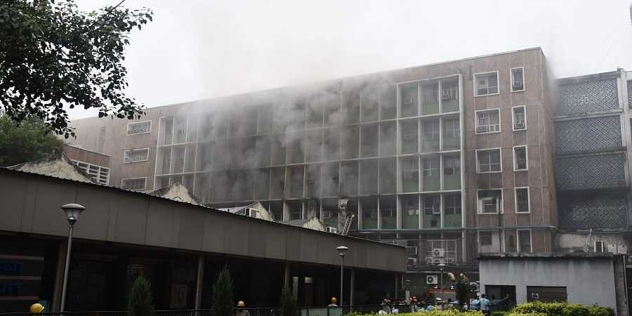 Smoke billows out as fire personnel douse fire which broke out at the teaching block of the All India Institute of Medical Sciences AIIMS in New Delhi