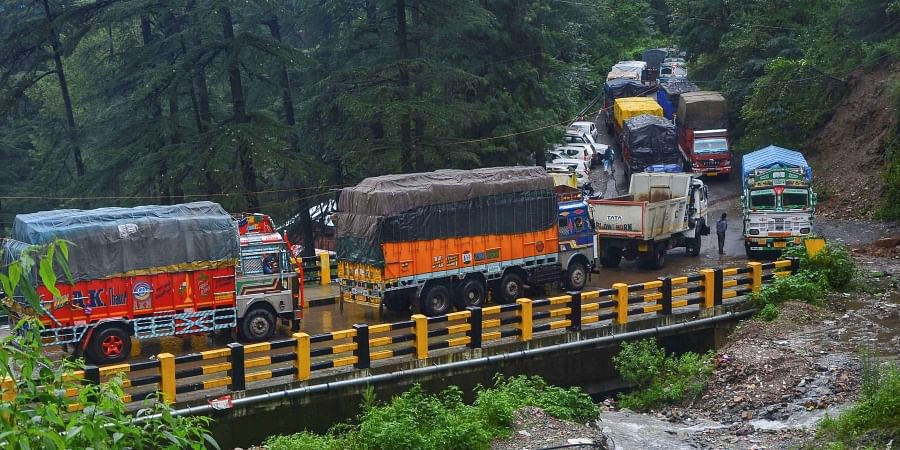 Vehicles stuck on a road following a landslide due to heavy monsoon rain in Shimla.