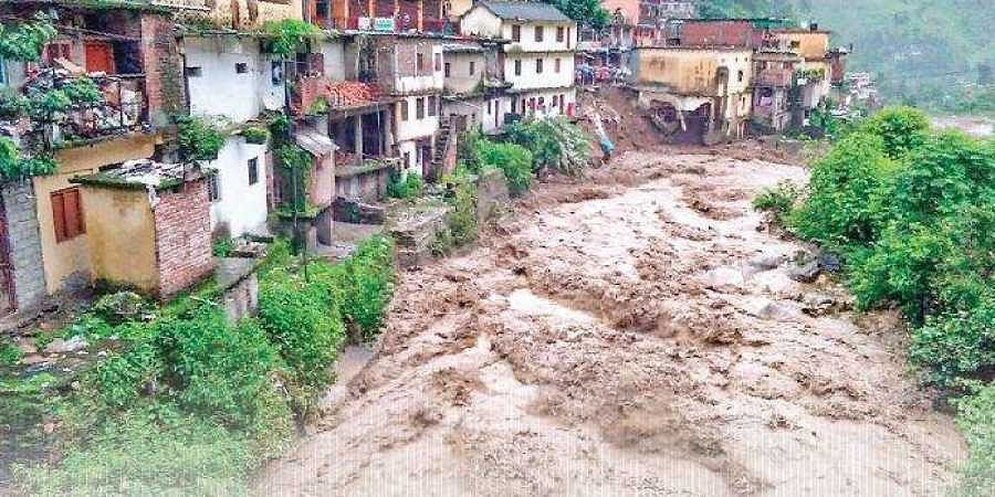 Floodwaters gush down the Chuflagad river in Chamoli district of Uttarakhand on Monday.