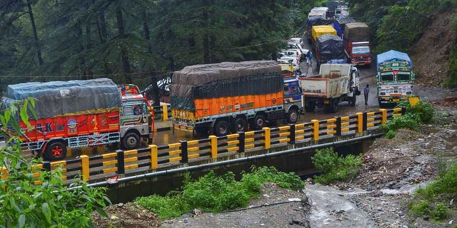 Vehicles stuck on a road following a landslide due to heavy monsoon rain in Shimla.