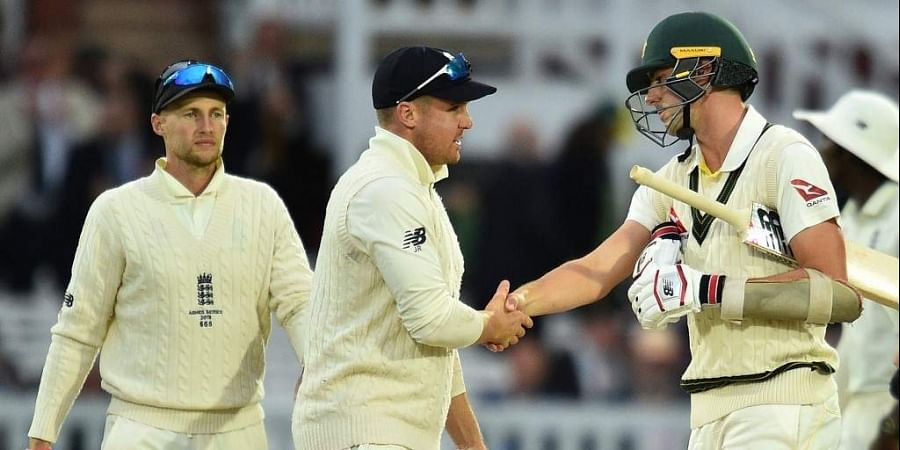 England's captain Joe Root (L) and England's Jason Roy (C) shake hands with Australia's Pat Cummins following the last over on the fifth day of the second Ashes cricket Test match. (Photo | AFP)