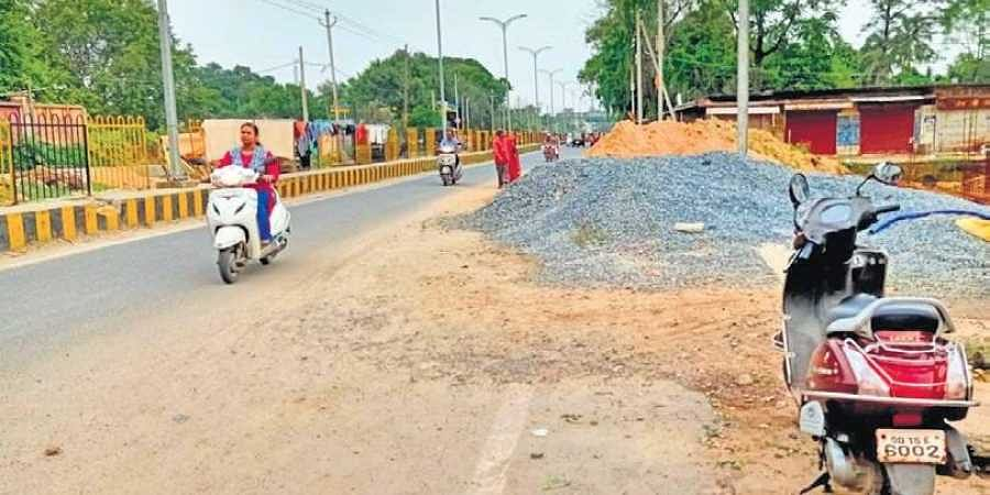 A heap of sands and stone dumped along the main road in Sambalpur