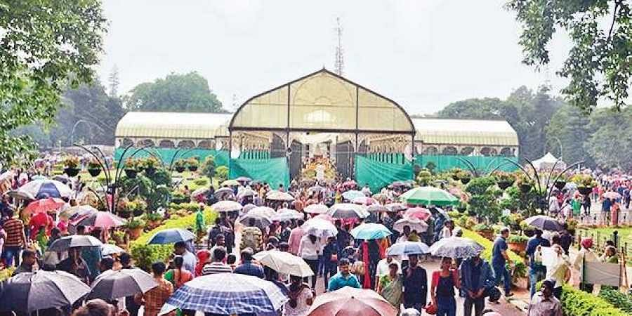 On the last day of the flower show at Lalbagh, many citizens thronged the venue even when though it rained in Bengaluru