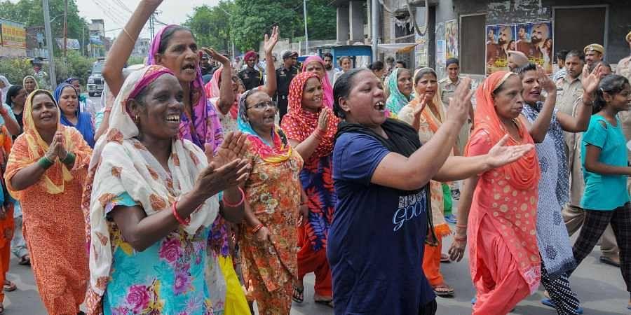 Members of Guru Ravidas Sabha Punjab during a protest march over demolishment of Guru Ravidas temple in Delhi in Amritsar.