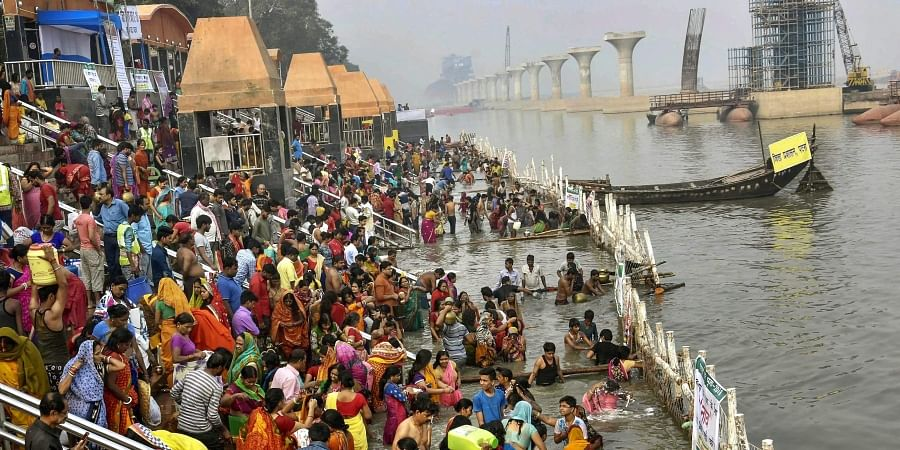 Devotees take a holy dip in the Ganga river during Nahay Khay Puja of the Chhath Puja festival in Patna. (Photo | PTI)
