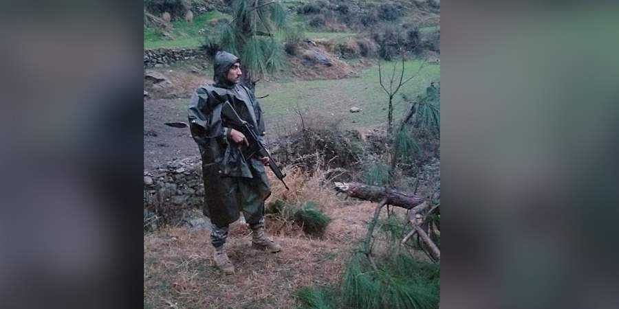 A Pakistani soldier stands guard in the area where Indian jets conducted air strike in Jaba near Balakot, in Pakistan