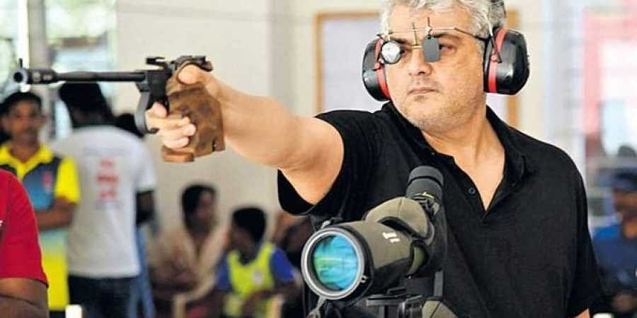 Actor Ajith Kumar at a rifle shooting event.
