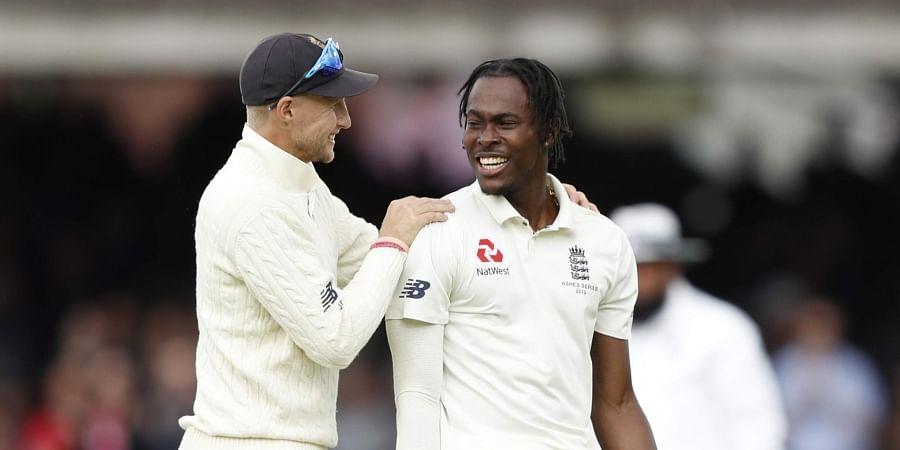 England's captain Joe Root congratulates England's bowler Jofra Archer. (Photo | AP)