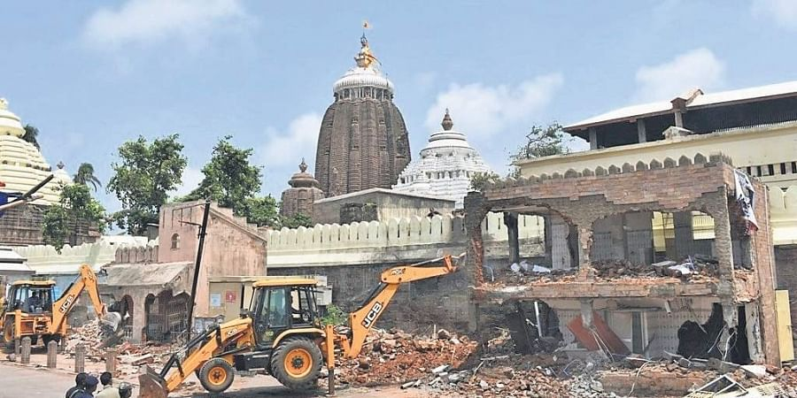 An illegal structure being demolished near Srimandir in Puri on Monday.