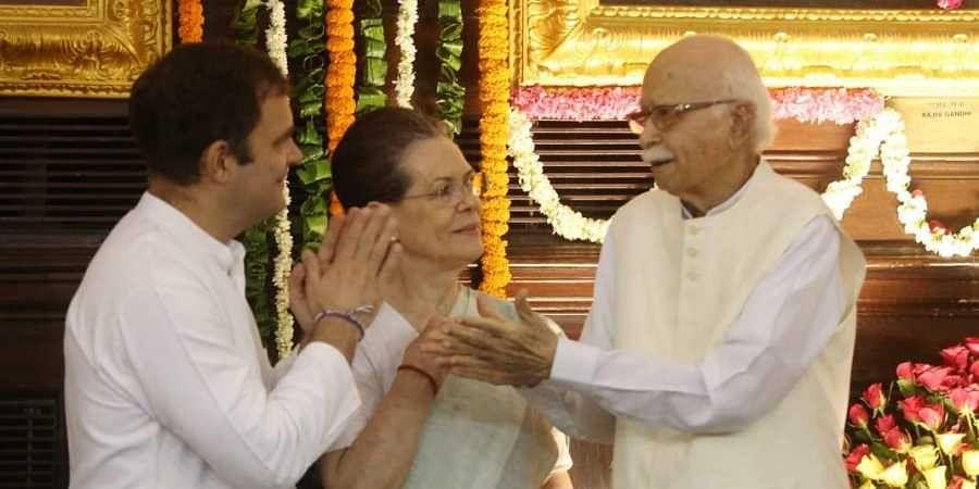Congress interim president Sonia Gandhi, Rahul Gandhi, BJP senior leader LK Advani pay  floral tribute to Former Prime Minister Rajiv Gandhi on his Birth anniversary at Parliament house in New Delhi on Tuesday.