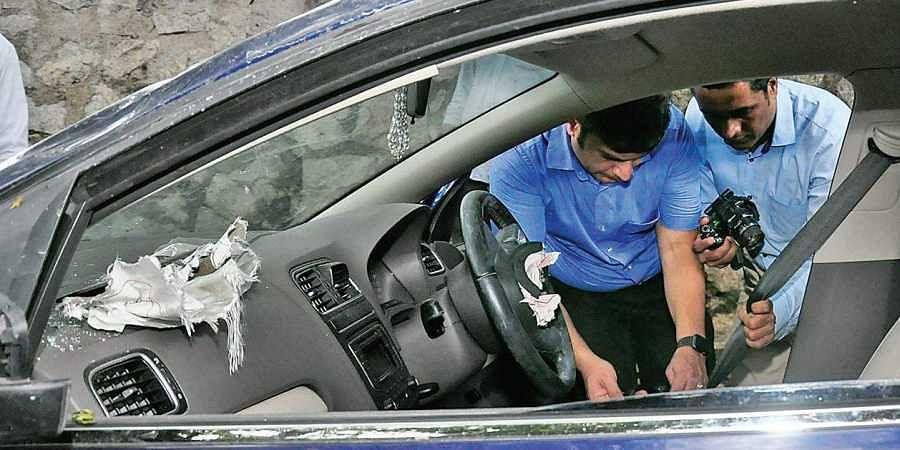 Experts of Volkswagen company examining the car driven by Sriram Venkataraman in Thiruvananthapuram on Monday