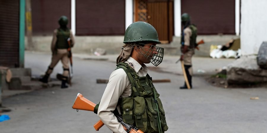 Paramilitary soldiers stand guard during security lockdown in Srinagar.