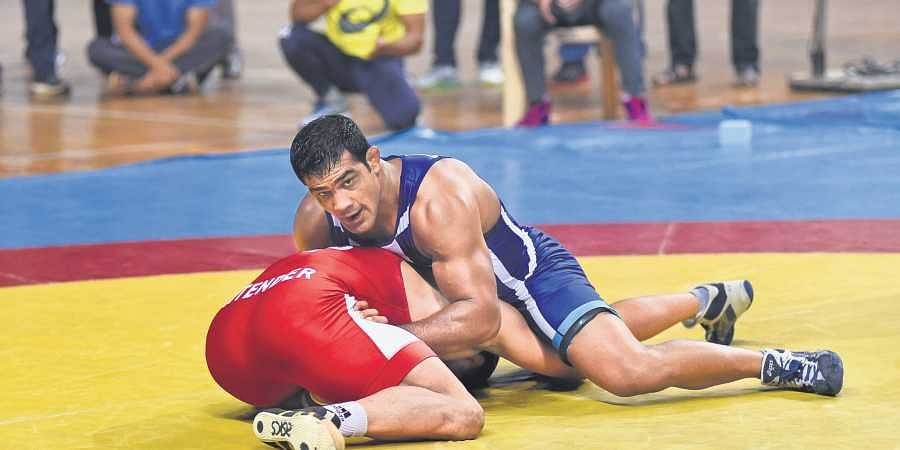 Sushil Kumar in action against Jitender Kumar during trials for the World Wrestling Championships at KD Jadhav Indoor Hall in New Delhi on Tuesday.