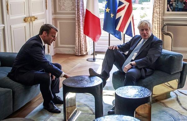 British PM Boris Johnson puts foot on table in French President Emmanuel Macron's palace