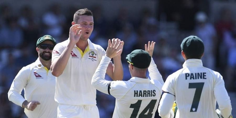 Australia's Josh Hazlewood (2L) celebrates taking the wicket of England's Jonny Bairstow on the second day of the third Ashes cricket Test match between England and Australia at Headingley in Leeds. (Photo | AFP)