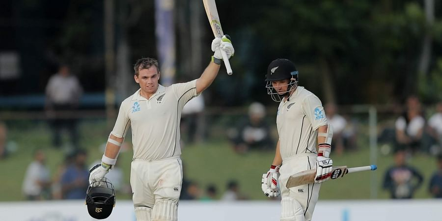 New Zealand's Tom Latham, left, celebrates scoring a century as BJ Watling watches. (Photo   AP)