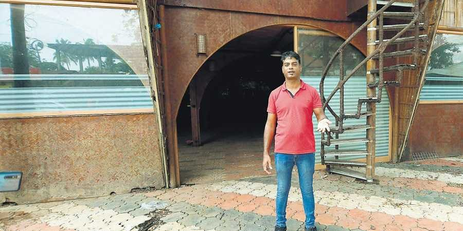 Jiju KP in front of his bamboo-themed hotel near Angamaly railway station