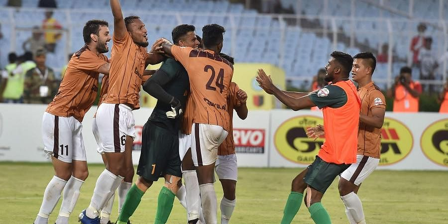 Gokulam Kerala FC footballers celebrate with their goalkeeper C.K.Ubaid after their win against East Bengal in a tie breaker shootout during 1st semi-final match of Durand Cup. (Photo | PTI)