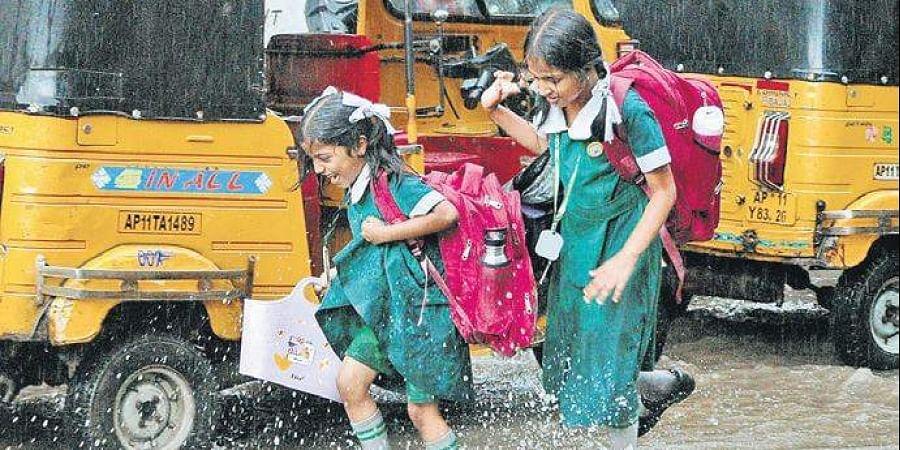 School children play in the rain.