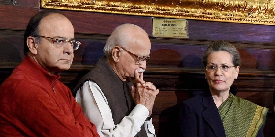 Union Minister Arun Jaitley with BJP senior leader LK Advani and AICC President Sonia Gandhi at an event to pay tribute to former PM Indira Gandhi on her birth anniversary at Parliament House in New Delhi on 19/11/2016. (Photo | PTI)