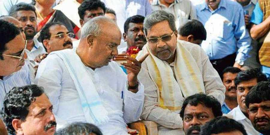 JD (S) supremo HD Deve Gowda and Congress leader Siddaramaiah
