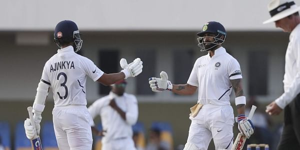 India's captain Virat Kohli, right, is greeted by teammate Ajinkya Rahane after scoring a half century against West Indies during day three of the first Test cricket match at the Sir Vivian Richards cricket ground in North Sound, Antigua and Barbuda, Saturday, Aug. 24, 2019. | AP
