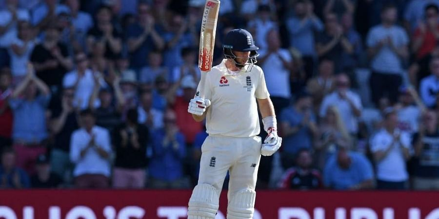 England's captain Joe Root reacts to reaching his fifty on the third day of the third Ashes cricket Test match between England and Australia at Headingley in Leeds. (Photo   AFP)