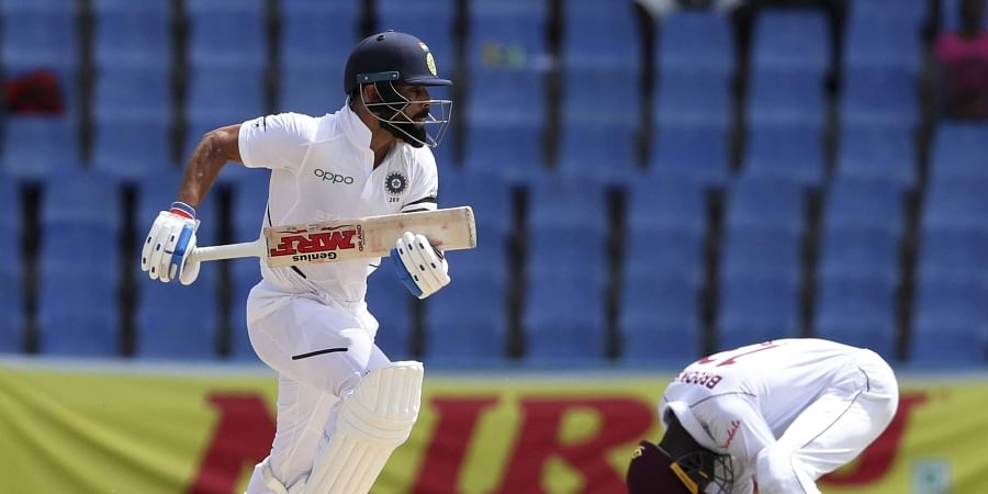 India's captain Virat Kohli scores runs against West Indies during day three of the first Test cricket match at the Sir Vivian Richards cricket ground in North Sound. (Photo | AP)